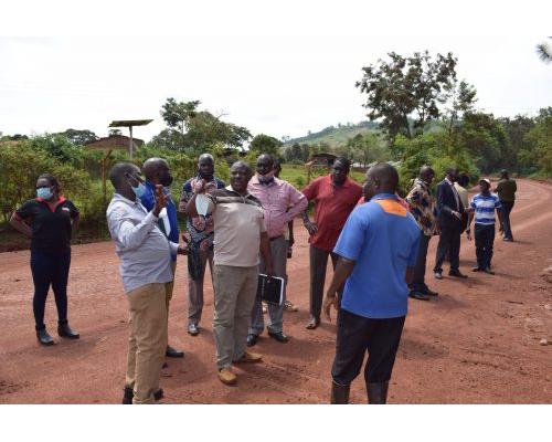 Citizens around Busoga College Mwiri celebrate the new tarmac